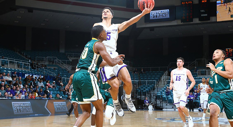 Payten Ricks attempts a layup in the Southland Conference Tourney