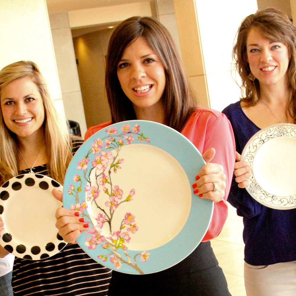 Designer and alumnus Darbie Angell shows off her latest floral design on a plate.