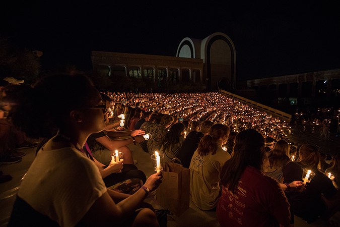 Students sitting in the amphitheater during the traditional Candlelight Devo