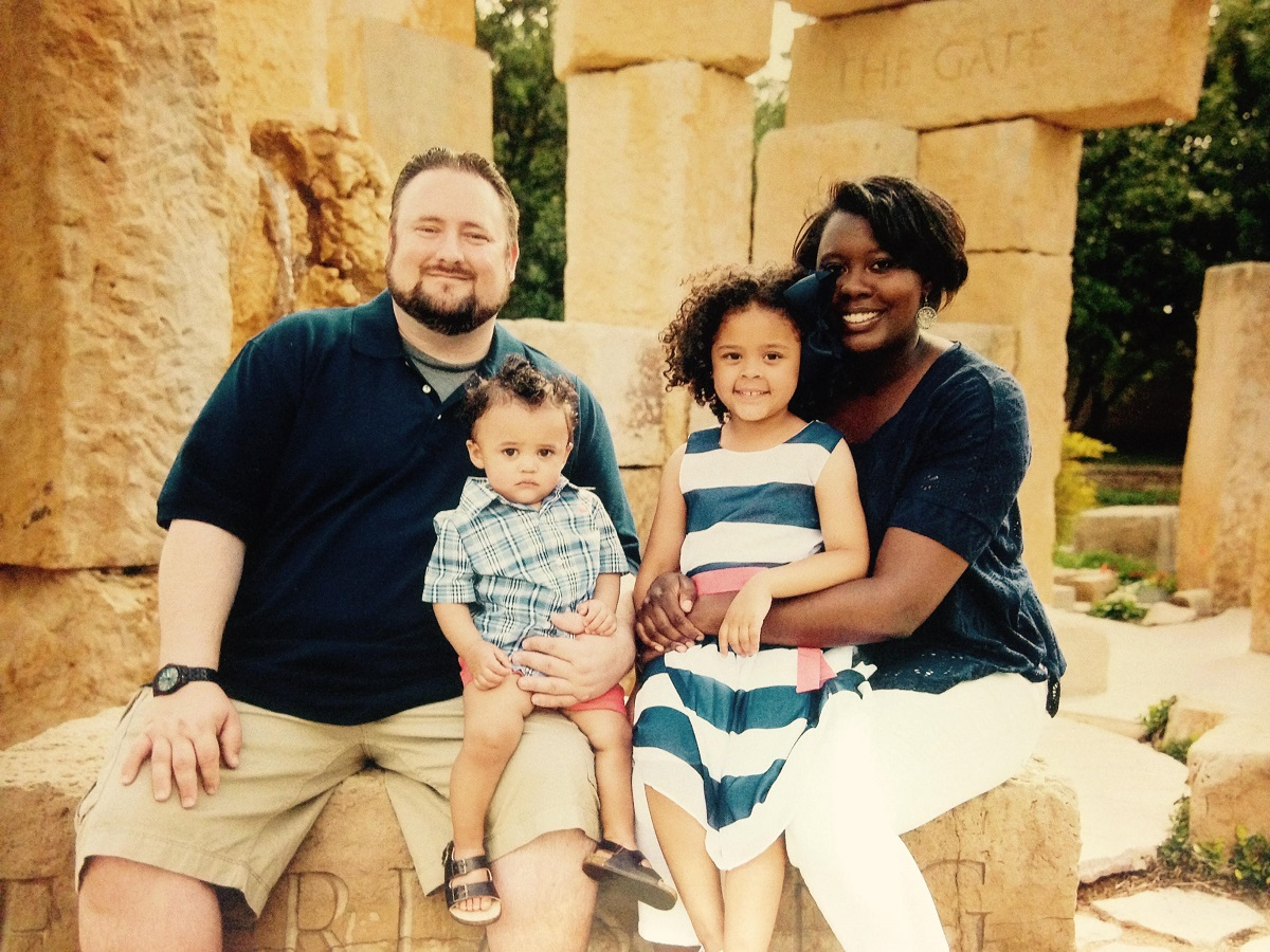 Family shot of Justin Whiteley at the Jacob's Dream statue on ACU's campus