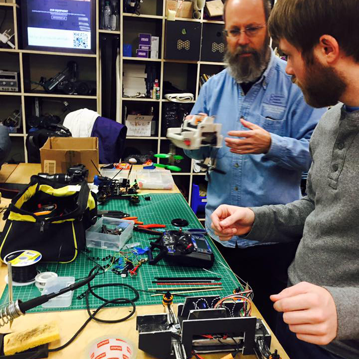 Student and prof work on electronics in the ACU Maker Lab