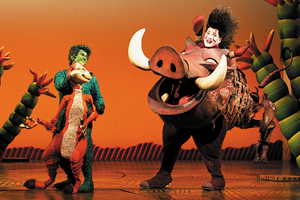 Timon and Pumbaa on stage at Broadway