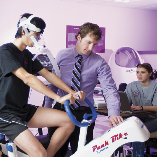 Athlete being tested for endurance on stationary bike