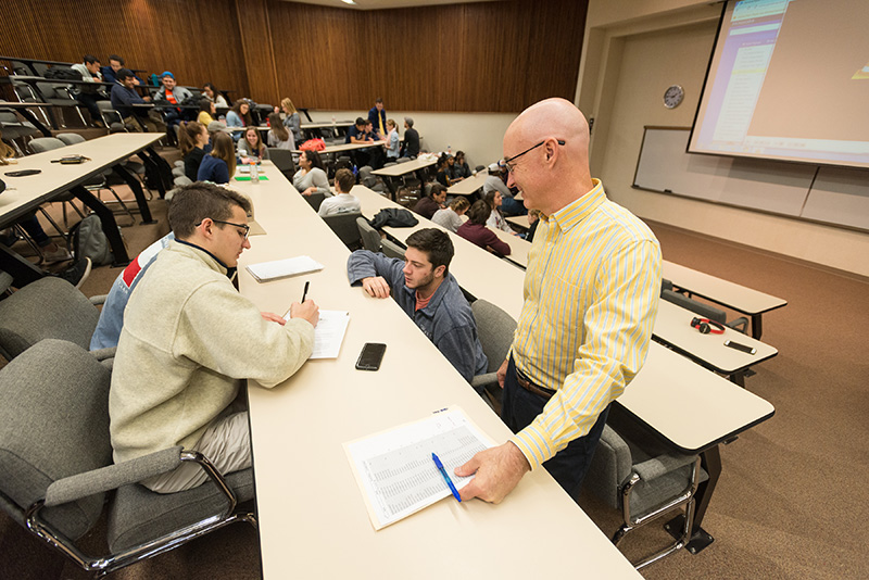 Students and professor working in class