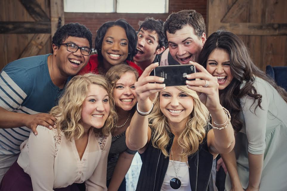 Students taking group selfie.
